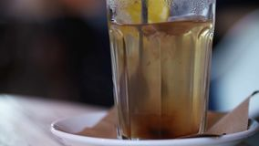 Treatment of Flu. Transparent cup of warm water with lemon and honey.  stock footage
