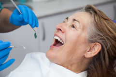 Treatment of gingivitis at the dentist. Mature woman in the treatment of gingivitis at the dentist Stock Photography