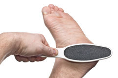 Treatment of hard skin Stock Image