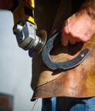 Treatment of horseshoe Royalty Free Stock Image