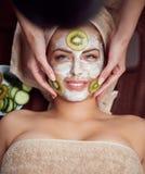 Treatment with kiwi mask on facial skin Stock Photo