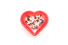 Treatment of medicines and pills. In a read heart Royalty Free Stock Photos