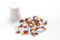 Treatment of medicines and pills. In a white background Royalty Free Stock Photos