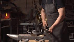 Treatment of molten metal close-up. Handmade blacksmith. Stock Photo