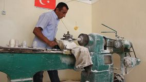 Treatment of onyx on a machine-tool. TURKEY, JUNE 22: 2011: Treatment of onyx on a machine-tool, Turkey, June 22, 2011 stock video footage