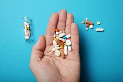Treatment and pharmacy concept. Overdose pills and drugs stock photos