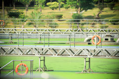 Treatment Plant. Sewage treatment plant surrounded by green grass Royalty Free Stock Photos