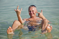 Treatment of the sea. A man bathing in the Dead Sea Stock Image