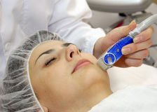 Treatment of skin currents. Is in a beauty salon Stock Photo