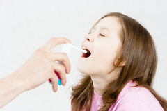 Treatment of sore throat. Medicinal spray. Treatment of sore throat. Medicinal kids spray Stock Images
