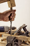 Treatment of wooden parts with a chisel. Treatment of wooden parts in a vice with a chisel royalty free stock images
