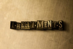 TREATMENTS - close-up of grungy vintage typeset word on metal backdrop Royalty Free Stock Images