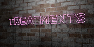 TREATMENTS - Glowing Neon Sign on stonework wall - 3D rendered royalty free stock illustration Stock Photo