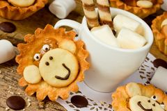 Treats on a children`s holiday, homemade cake shaped monkey, cre Royalty Free Stock Image