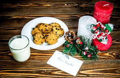 Treats for Santa Claus on a wooden table. Stock Photography