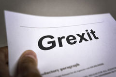 Treaty with title Grexit. Man holding an treaty with title Grexit Stock Images