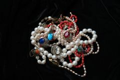 Treausures from India. Pearl chains and rings with coloures glass such as Swarovsky look liked as rubin and sapphire. From India stock images