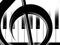Treble clef. Fragment of a treble clef on a background of keys of the piano Stock Photos