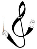 Treble clef as conductor Stock Photo