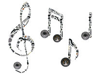 Treble clef assembled from new auto spare parts Royalty Free Stock Images