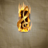 Treble clef in fire breakout. Vector illustration of old paper background with a fiery explosion and a gold treble clef Stock Images