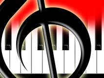 Treble clef and keys of the piano. Fragment of a treble clef on a background of keys of the piano Stock Images