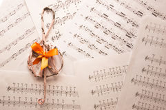Treble clef on music sheets back Royalty Free Stock Photos