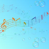 Treble clef musical signs on a blue background Stock Image