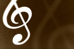 Treble Clef musical symbol. On a sheet music Royalty Free Stock Images