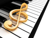 Treble clef is on the piano. Keys Stock Photo