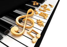 Treble clef is on the piano. Keys Stock Image
