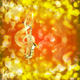Treble clef and a saxophone against bright background with flares Stock Images