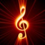 Treble clef shine. Shiny orange treble clef symbol Stock Photography