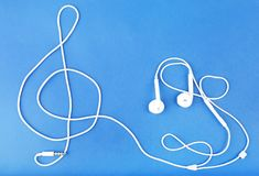 Treble clef sign made of earphones Stock Photo