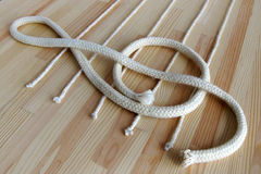Treble clef and stave. Made with white ropes on the deck Royalty Free Stock Image