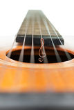Treble clef on the strings of a guitar Royalty Free Stock Photo