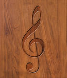 Treble clef on wood Stock Photography