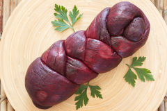 Treccia - braided Mozzarella cheese bundle marinated in red wine Royalty Free Stock Image
