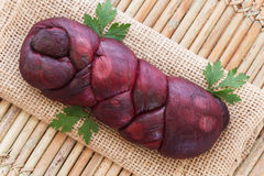 Treccia - braided Mozzarella cheese marinated in red wine on sac Stock Images