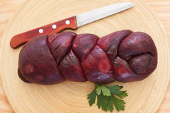 Treccia braided Mozzarella  marinated in red wine with knife Royalty Free Stock Image