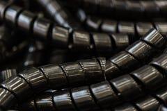 Treccia di plastica nera della selezione del cavo fotografie stock libere da diritti