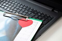 Red heart next to keyboard of laptop, top of view. Concept thank you doctor, medical personnel