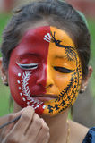 Treditional Indian painting designs on Face. Students of National Institute of fashion technology, Bhopal an institute run by Ministry of textiles, government of Stock Image