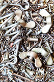 Metal fasteners. Closeup shot of metal fasteners - nails, bolts, nuts, screws, springs and other royalty free stock images
