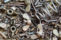 Metal fasteners. Closeup shot of metal fasteners - nails, bolts, nuts, screws, springs and other stock image