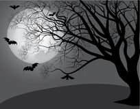 Tree against the moon Royalty Free Stock Photos