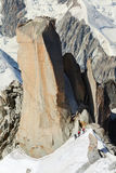 Tree alpinists ascend on cliff in Alps. In sunny day stock photos