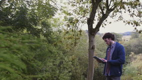 Tree Analysis with Digital Tablet stock footage