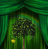 Tree and apple before curtains. Tree and golden apple before curtains Royalty Free Stock Photo