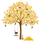 Tree with Autumn Leaves and Halloween decorations Royalty Free Stock Photo